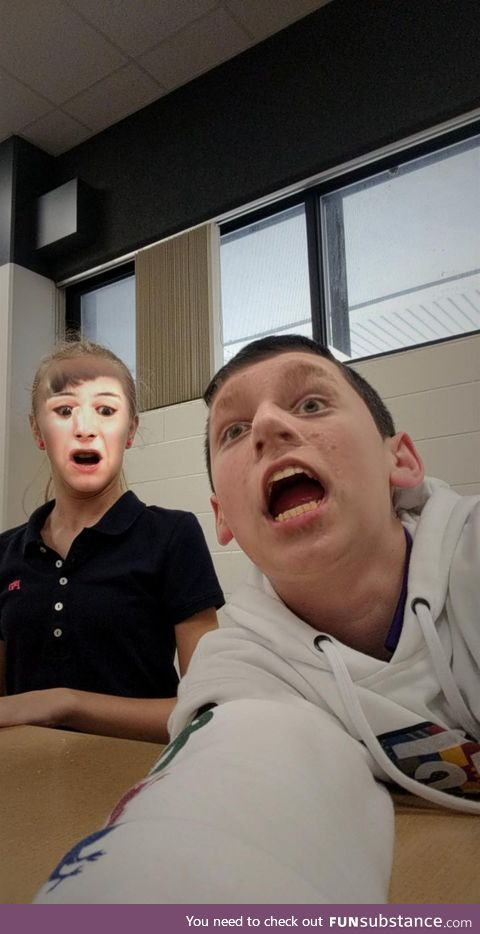 My friend and I did face swap at school. I'm the one in the back.