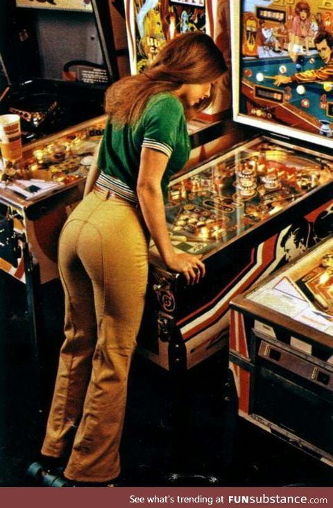 Woman playing pinball (1978)