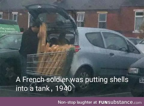 A French soilder was putting shells into a tank. 1940