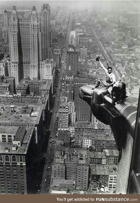 Aug 8 1932... two workers clean the eagle ornamentation on The Chrysler Building in NYC.