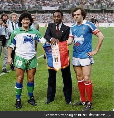 "It is year 1986. Maradona is wearing ""no drugs"" shirt. Platini is wearing"