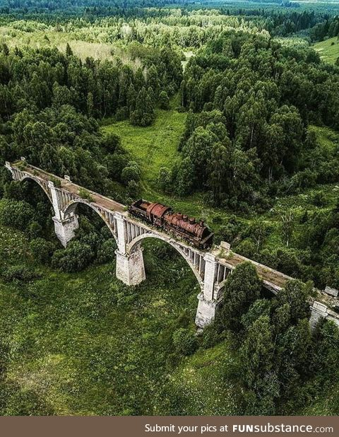 This abandoned railroad track with train still on it