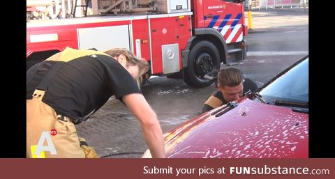 Dutch firefighters washing cars with profits going to help Australian firey bros