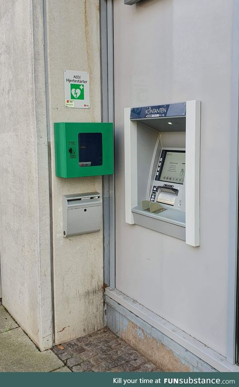 This ATM in Denmark with a defibrillator hanging right next to it, just in case you get a