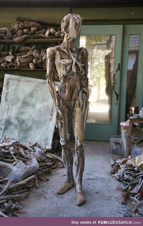 Statue made out of driftwood