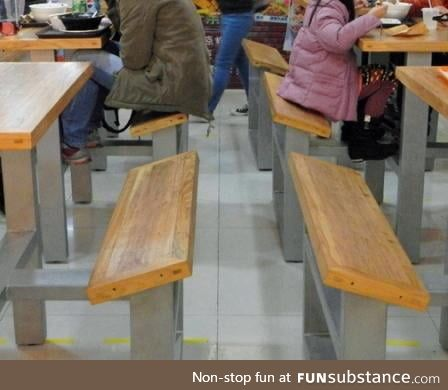 Tilted benches in a food court so customers would leave sooner - literal