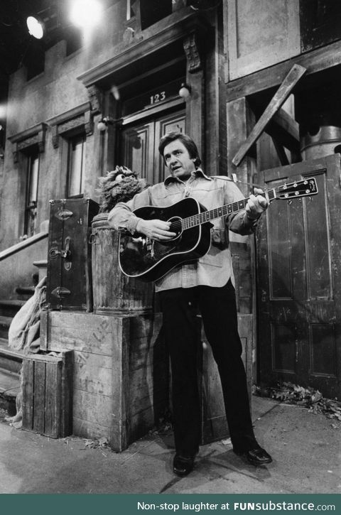 Johnny Cash singing to the first homeless Muppet, circa 1977