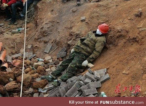A Chinese worker on the construction site for Huo Shen Shan hospital, finished in 9 days