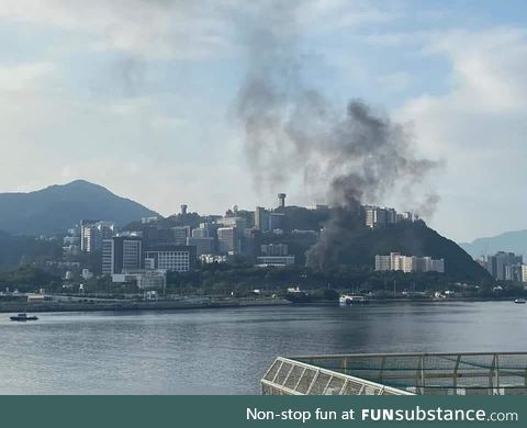 Smoke from TEAR GAS over a college campus, CUHK, in Hong Kong, where the police entered
