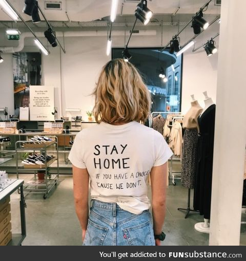 Belgian employee of & Other Stories, part of H&M, protesting the fact that she has to