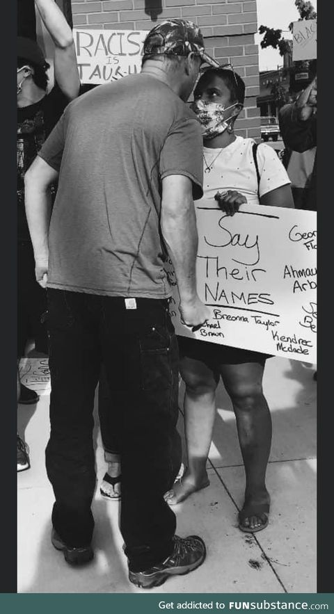 Woman stands strong in the face of hate during a BLM protest