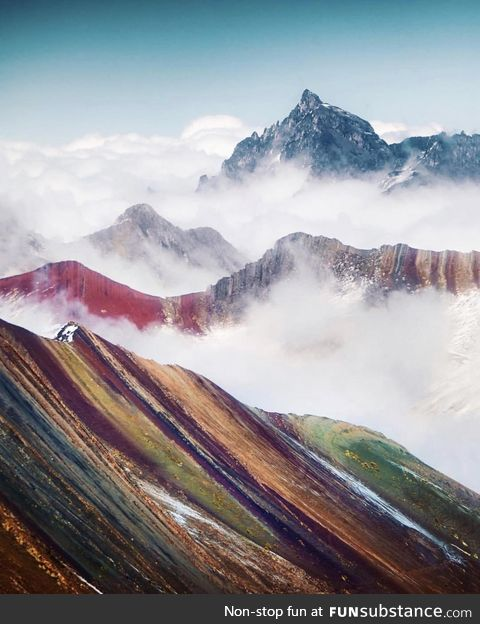 Clouds over Rainbow Mountain in Peru