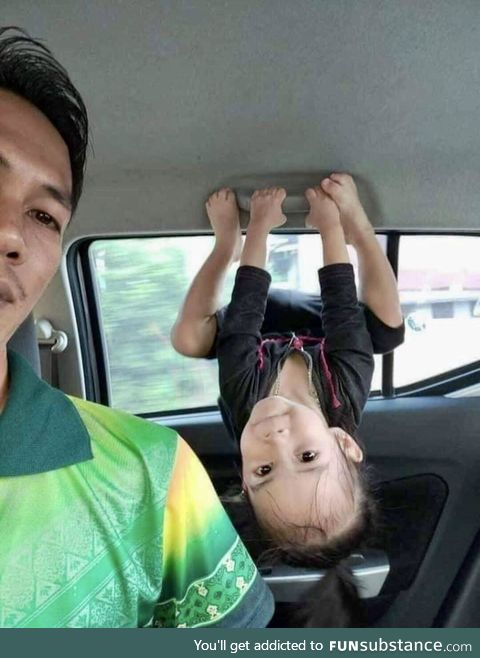 This little girl doing her best Batgirl impression with her dad
