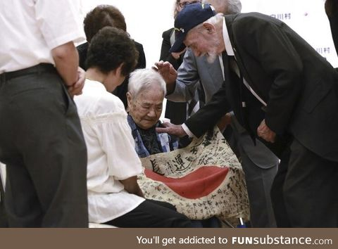 US marine returning a flag to a fallen Japanese soldier's family. This is the only