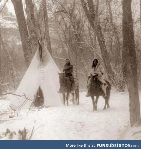 An incredible photo showing two Apsaroke Indians during Winter Camp in 1908. Edward