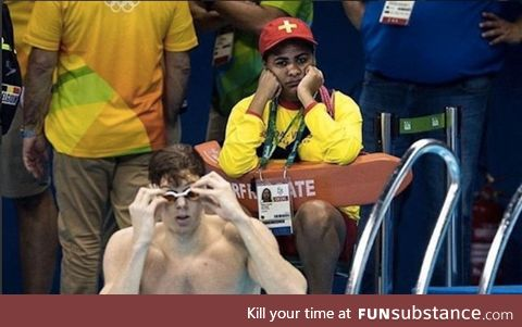 If you ever feel useless, this is the lifeguard at the swimming Olympics