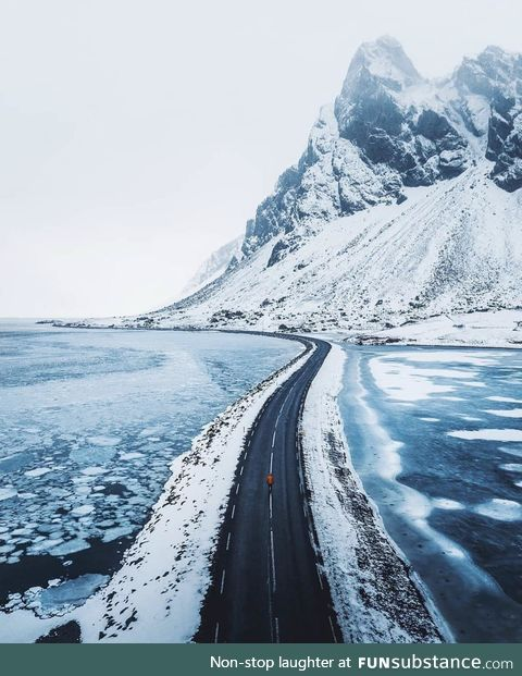 The frozen waters surrounding the road