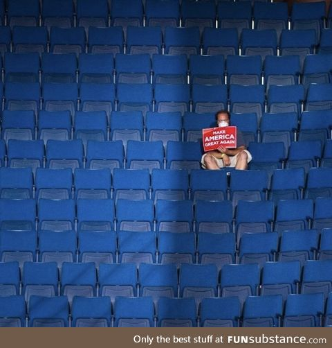 A single Trump supporter in a sea of empty blue seats in Tulsa today