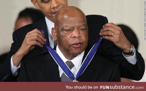 Barack Obama awarding the presidential medal of freedom to the late representative John
