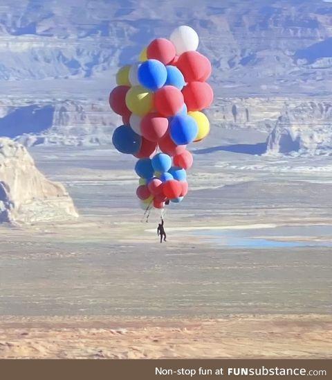 David Blaine nonchalantly floating over Arizona holding 52 helium balloons