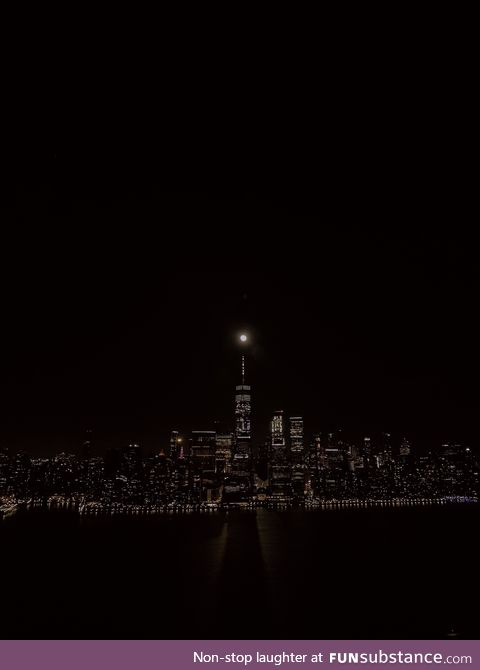 The moon aligned with the World Trade Center and cast a shadow over the Hudson tonight