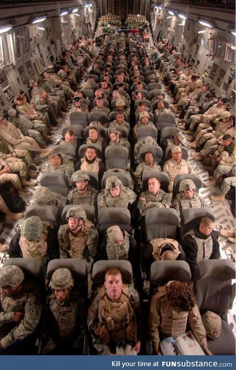 Soldiers Coming Home From War. Rare view inside a military transport