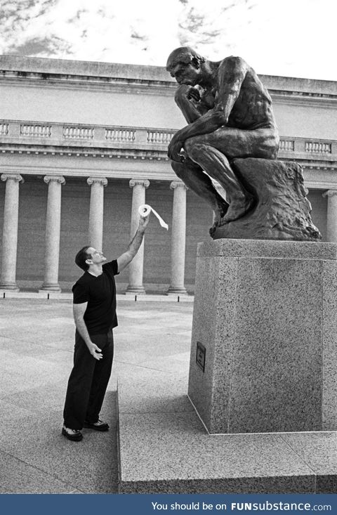 Robin Williams offering a toilet roll to The Thinker (early 90s)