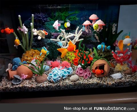 Incredibly detailed aquarium featuring underwater creatures all made out of crocheted yarn