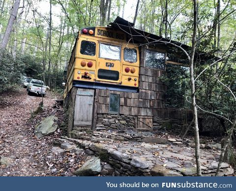 School bus converted into part of a house