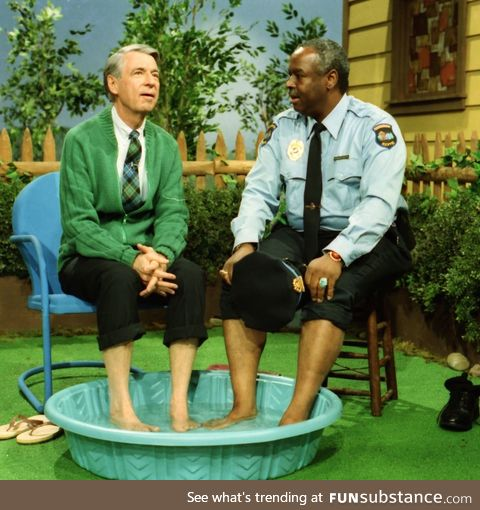 Mr Rogers breaking racial boundaries by sharing a pool with Officer François Clemmons