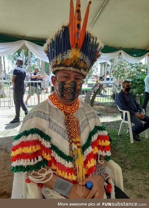 Indigenous man with face mask matching his beautiful traditional attire