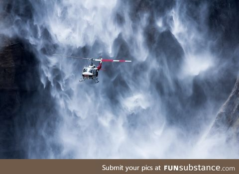 A helicopter near Yosemite waterfall, USA