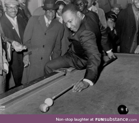 Martin Luther King Jr playing pool after a march