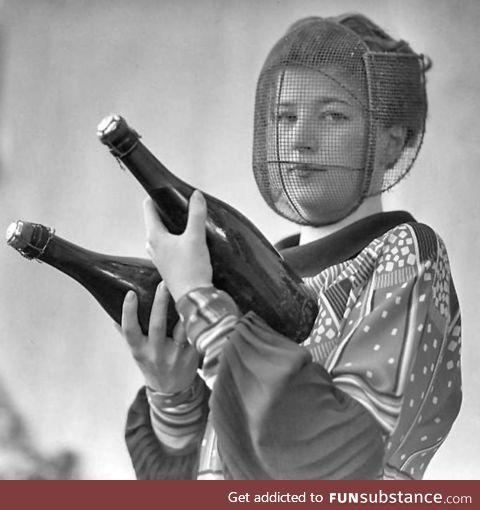 A champagne inspector wearing a special mask to protect against accidental discharge,