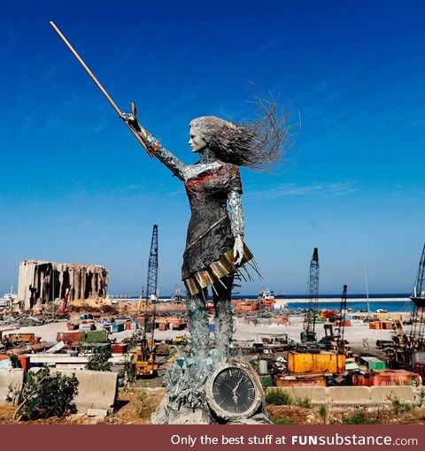 The Beirut lady statue , made of some of the debris of the explosion happened that back