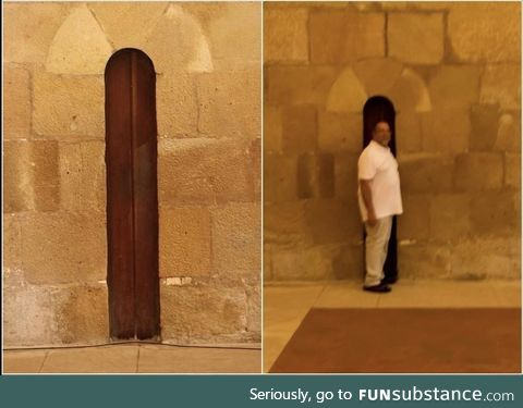 The door to the dining area of the Alcobaça Monastery in Portugal was made narrow so