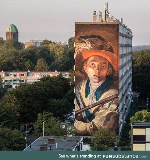 A huge mural on the side of a flat