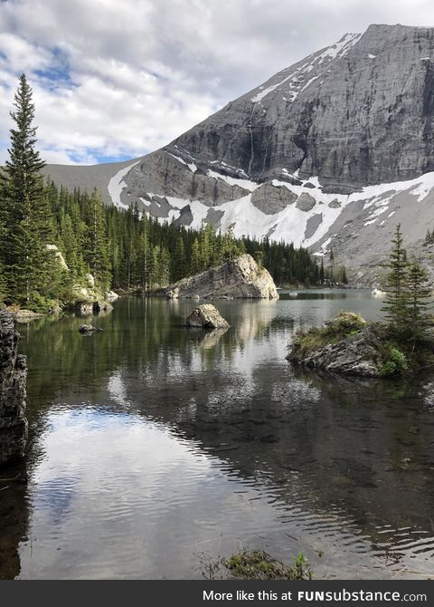 A river running by a mountain in the Canadian Rockies