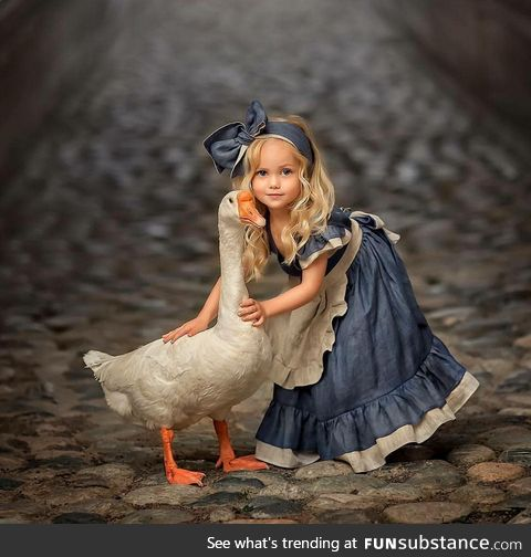 A Girl and a Goose,the eyes are way too soulful..!!