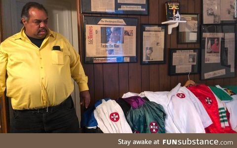 Daryl Davis, who befriended dozens of KKK members, shows off collection of robes