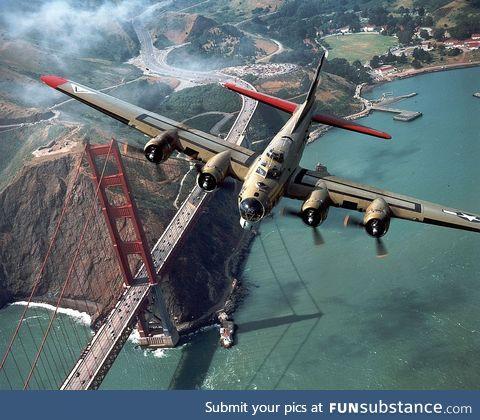 B-17 WWII bomber beautifully flying over the Golden Gate bridge