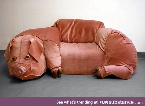The pig couch even smells of bacon, naturally