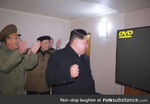 Civilians celebrate as Kim Jong Un invents a new device called television, 2014