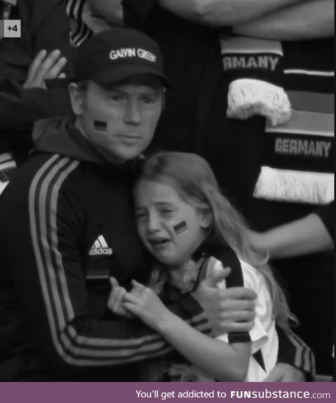German Father comforts his daughter as they overlook the battle for the Rhine